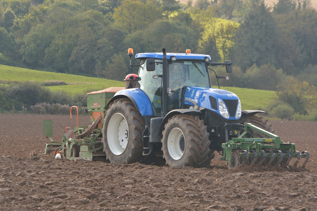 New Holland T7 235 Tractor with an Amazone ADP 303 Special