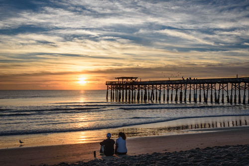 cocoabeach sunrise couple ocean pier sand sky surf chuckpalmer outdoor travel