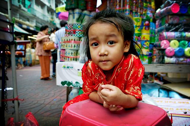 red girl in a bangkok market