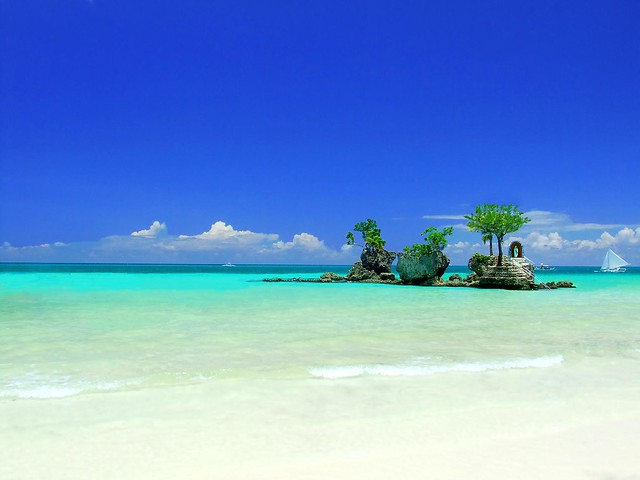 Boracay Island  White Sand and  Willy's Rock surrounded by Blue Sky and Blue Sea