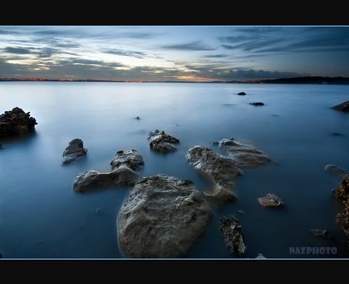 blue light sunset sea newzealand sky beach water yellow clouds rocks border auckland abbas pointchevalier bluish nazar sigma1020mm vosplusbellesphotos coylepark nazarab nazarabbas