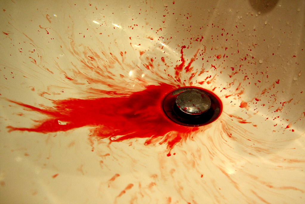 real blood | just nose bleed :) it was fun taking this pic ...