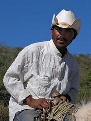 Cowboy with a white hat - Vaquero en el camino entre Ameca y San Rafael de las Tablas, Zacatecas, Mexico
