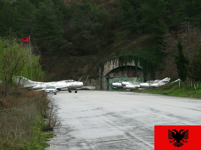 Ex Albanian Air Force stored aircraft guarding the gate towards the aircraft cavern shelters at Kucove Airbase, near the city of Berat in Albania. 14 March 2013.