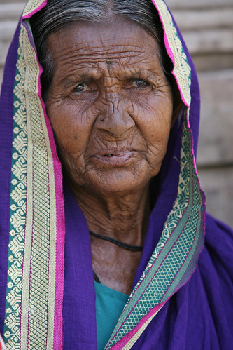 Portrait of an elderly woman   by World Bank Photo Collection