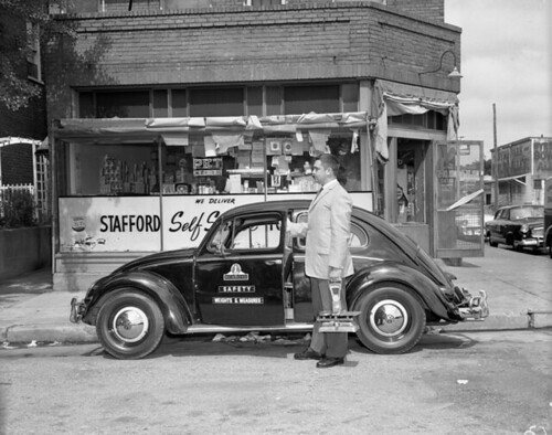 Richmond weights & measures inspector outside Stafford Self Service store | by The Library of Virginia