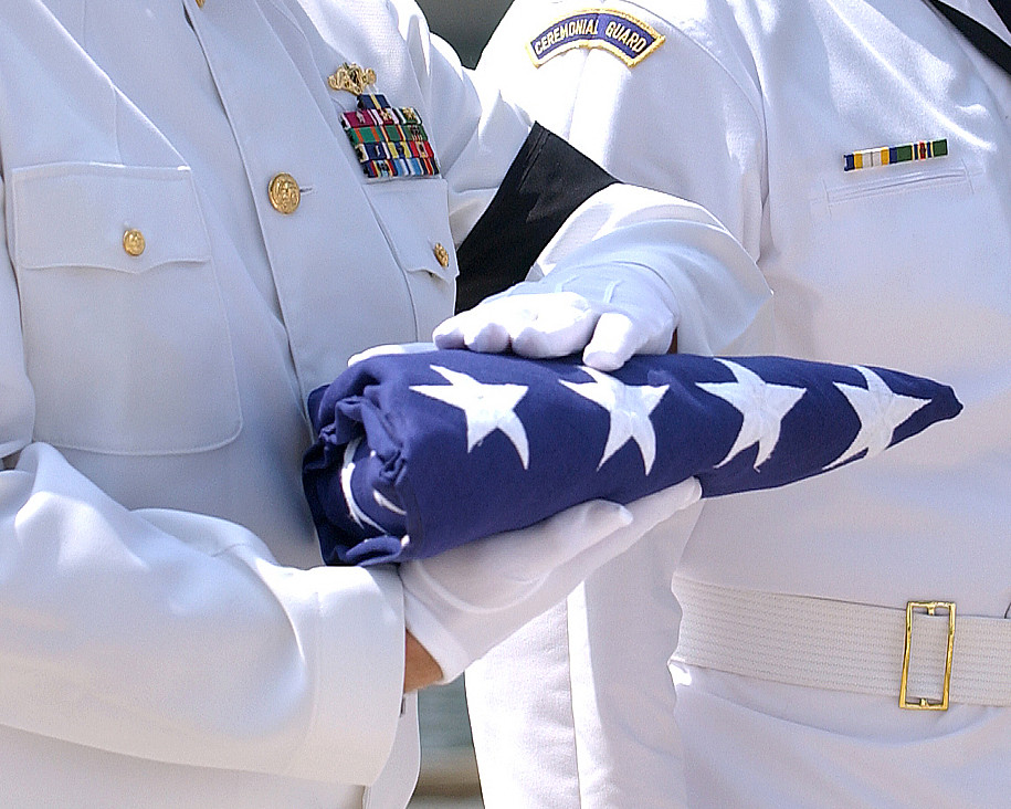 An American flag is prepared for presentation to the next of kin