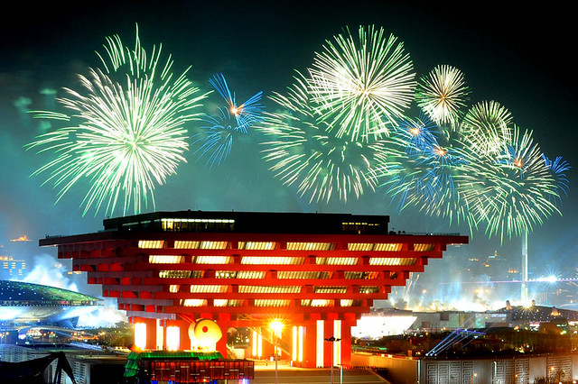 Fireworks explode behind the China Pavilion during opening ceremongy of 2010 world  expo in Shanghai 上海世博会开幕式烟花映照下的中国馆
