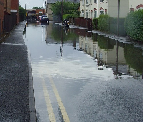 The yellow lines vanish into the flood water after the storm today | by Tony Worrall