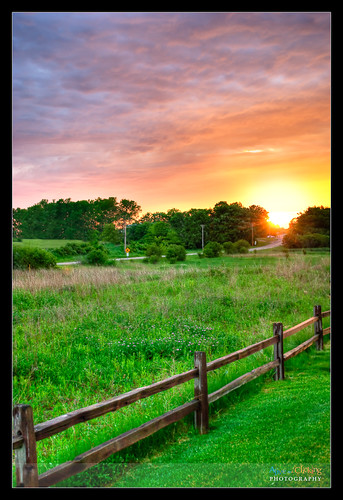 trees sunset orange storm green home grass fence illinois interestingness spring explore forestpreserve lakewood hdr lakecounty trailside wauconda explored millenniumtrail lcpfd