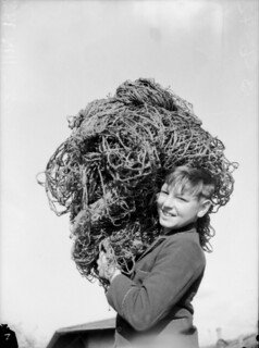 Boy with camouflage nets, 1942
