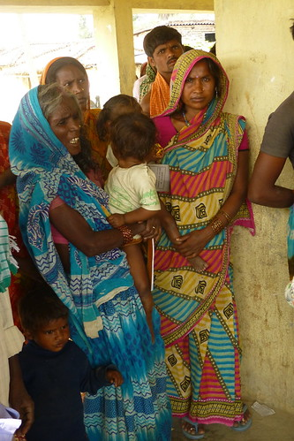 mothers queuing at a vaccination clinic