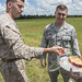 Staff Sgt. Austin Gootee, Joint Communication Support Element operator, watches as a fellow operator fills his uniform with cherry pie before a jump near MacDill Air Force Base, Fla. This is Gootee's first jump since jump school. Tradition states that cherry pie must be in his uniform during the jump. The JCSE's core mission it to provide premier communications, anywhere across the planet. (U.S. Air Force photo/Master Sgt. Brian Ferguson)