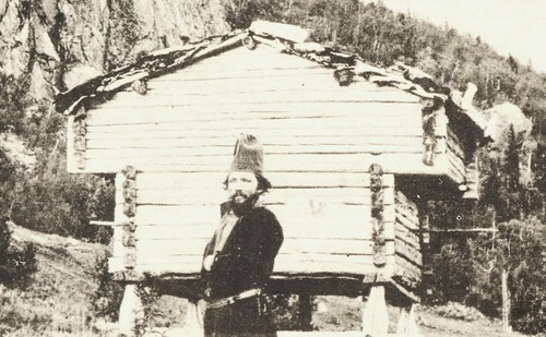 Sami man and a stabbur (Sami store house) from Västerbotten, Sweden | by saamiblog
