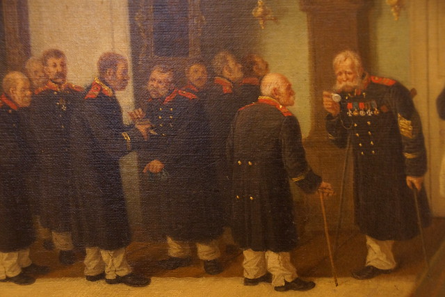 Leonid Ivanovich Solomatkin (1837–1883) Time for Dinner (Disabled War Veterans at the Door of a Canteen), 1878, oil on canvas (detail)