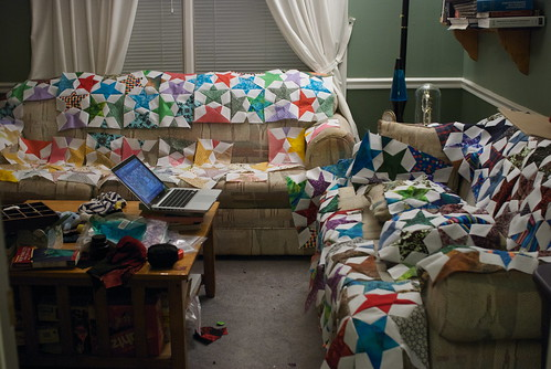 I can tell the end of the project is near because both couches have been consumed by the quilt.  (Nom.)