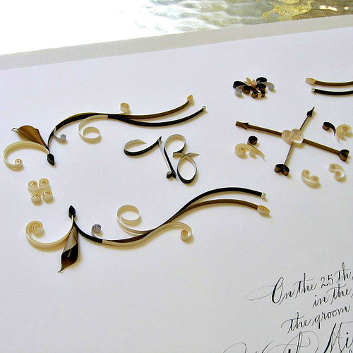 Quilled ketubah with monogram and paper scrolls