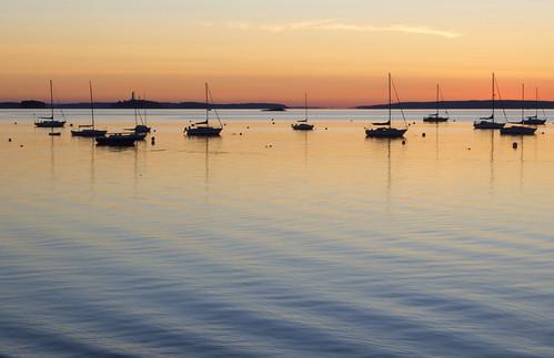 ocean morning sea usa sunlight water silhouette sunrise reflections boats still maine silhouettes newengland peaceful calm portlandmaine ripples sailboats easternpromenade nikond5100