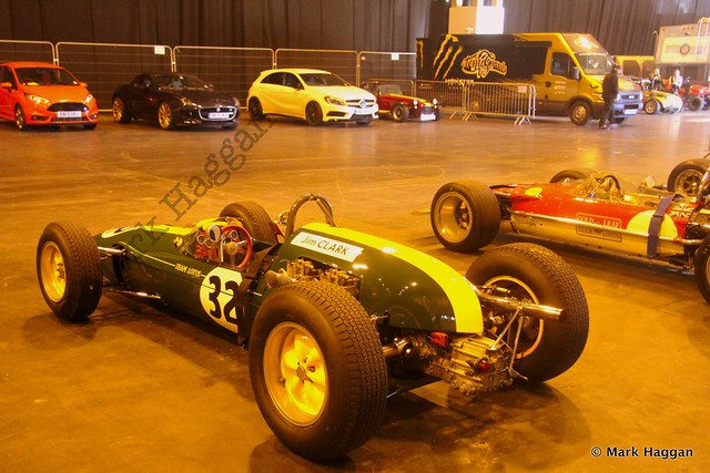 Jim Clark's Lotus behind the live arena show at the Autosport International Show 2014