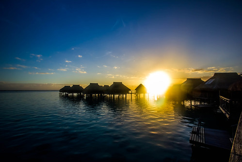 sunset french polynesia hilton bungalow moorea overwater