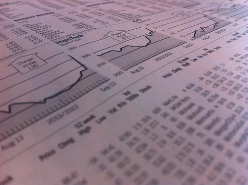 Stock market quotes in newspaper   by AndreasPoike