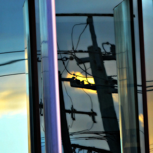 light sunset sky reflection window architecture dark outside afternoon exterior purple contemporary brisbane powerlines powerpole services steffentuck