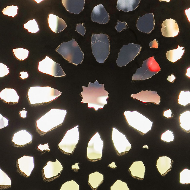 A red star with spider webs in the Alhambra