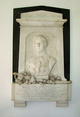 bust, sword and scattered flowers