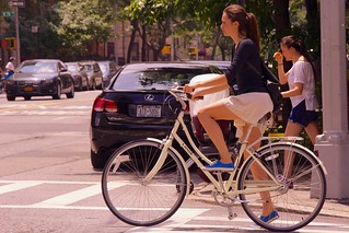A sign of the times: beautiful women still wear remarkably short skirts on their bicycles in NYC | by Ed Yourdon