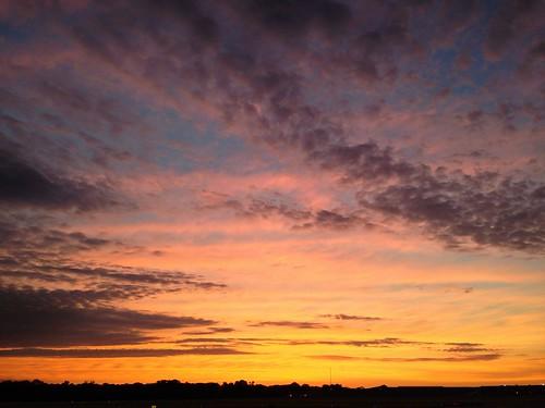 city morning blue light sky orange usa apple nature clouds sunrise airport day view cloudy littlerock peaceful arkansas tranquil cellphonephoto pulaskicounty centralarkansas iphone5 waltphotos lordwalt uploaded:by=flickrmobile flickriosapp:filter=nofilter