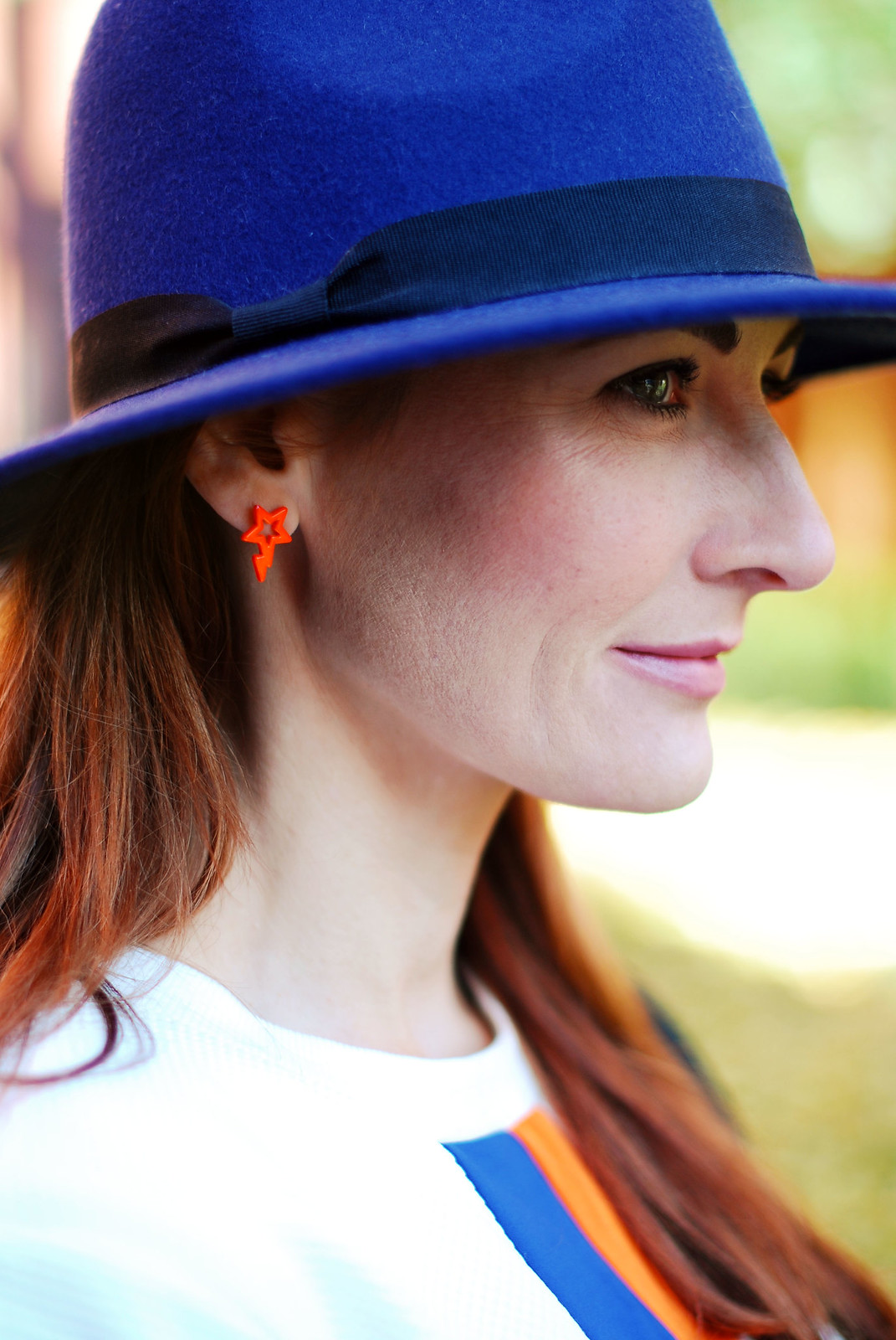 Blue fedora & neon earrings - Not Dressed As Lamb