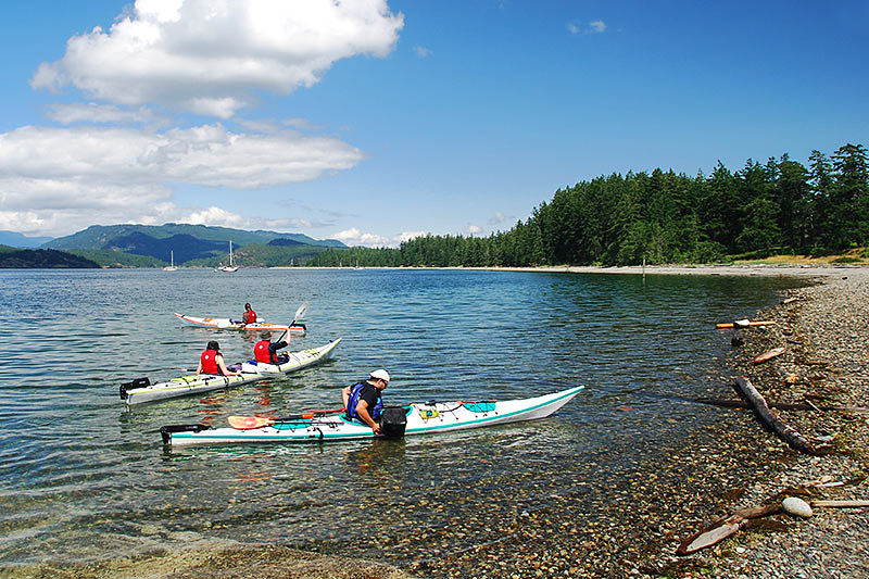 Kayakers at Rebecca Spit Marine Provincial Park, Quadra Island, British Columbia, Canada