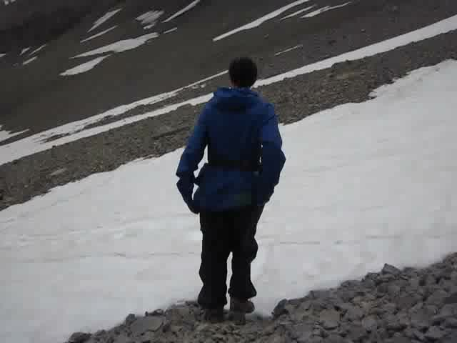 0486 Video of Vicki glissading down a snow patch as we descend from Bonnet Glacier toward Badger Pass
