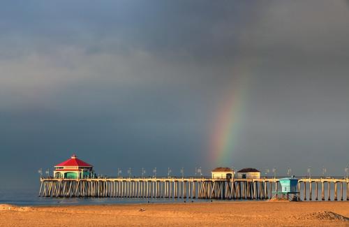 ocean california beach rain clouds sunrise pier rainbow pacific pacificocean huntingtonbeach huntingtonbeachcalifornia