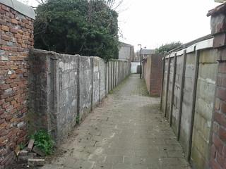 Remnants concrete fence sporting field Berchemseweg