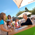 Jacqueline Wilson signing books for young readers in the sun |
