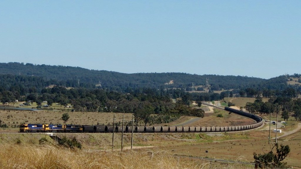Loaded PN coal train near Lake Liddell with Drayton Junction in the background- 19/9/13 by Adam Serena