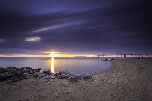 sandypointstatepark annapolis maryland chesapeakebay sunrise dawn sunflare longexposure leebigstopper neutraldensity filters beach water bridge outdoors rocks sand sundaymorning sliderssunday hss