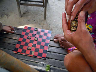 In Mandalay, a game with bottle caps | albatz | Flickr