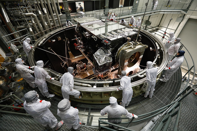 Engineers Watch the GOES-S Satellite Being Lowered into the Thermal Vacuum Chamber