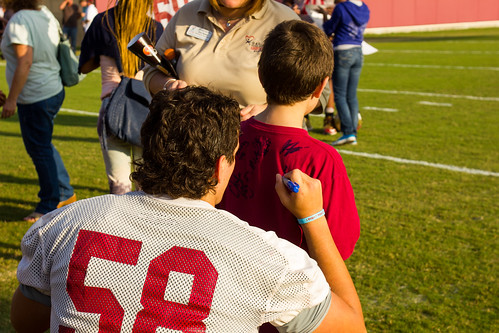 Guardian ad litem guest with a Florida State Seminoles football player at the Albert J. Dunlap Athletic Training Facility football practice fields in Tallahassee, Florida on October 8, 2013. | by flguardian2