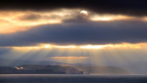 sunset water clouds coast seaside harbour stormy somerset coastline sunbeams crepuscularrays minehead watchet eastquantoxhead bridgwaterbay