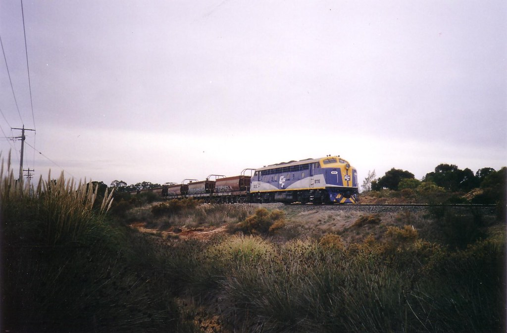 B76 on the rear of ballast train discharging at White Hills by bukk05