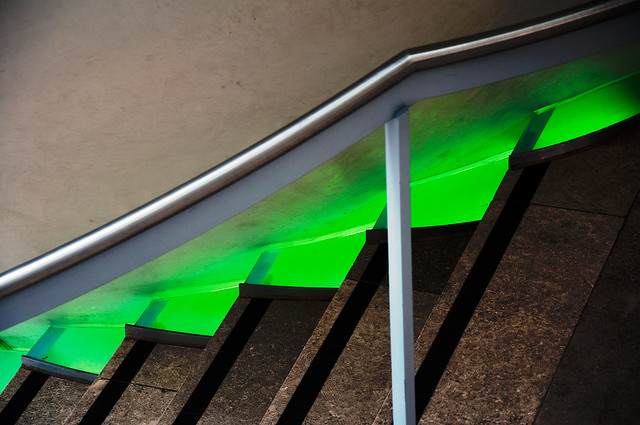 Staircase with neon green stripe inside the Natural History Museum, London, UK
