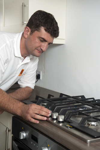 Man Checking Gas Stove | by CORGI HomePlan