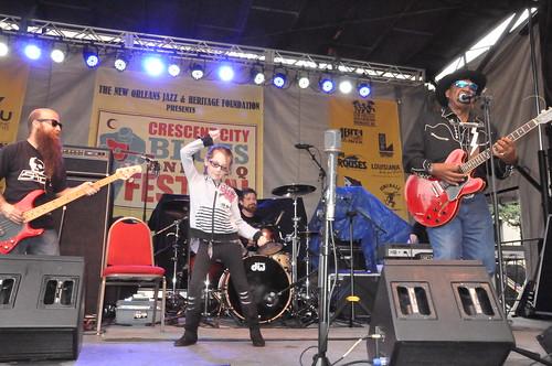Callie Hirsch dancing during Guitar Lightnin Lee's set at Crescent City Blues & BBQ Fest. Her dad Marvin Hirsch is on bass. Photo by Kichea S Burt.