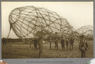 'India Office Official Record of the Great War'. - caption: 'The wrecked Zeppelin brought down by our aviators near the coast of Essex. The skeleton of an airship which crashed in a field. 1915.' | by The British Library