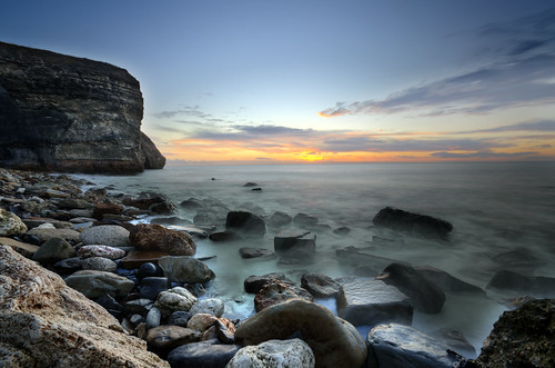 sea beach night sunrise rocks cloudy fair exotic partly pwpartlycloudy
