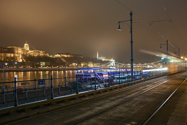 Budapest - the tram No. 2 moves along the Danube shore at night