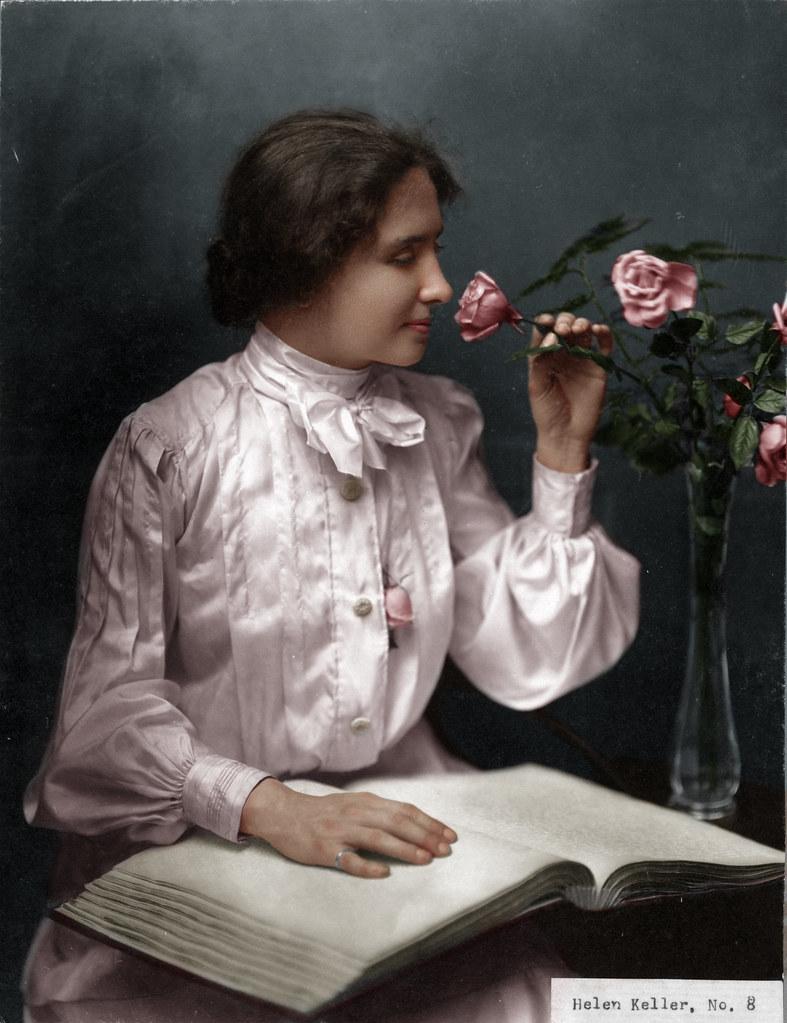 Helen Keller Smelling Roses (date unknown)